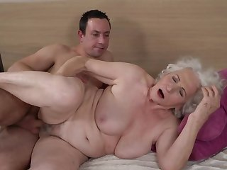 Grey-haired female gets her puristic cunt fucked unconnected with younger boy