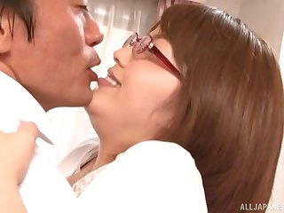 Brunette Japanese MILF with glasses gets cum on her tits after a fuck