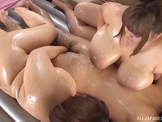 Oiled nearby Japanese BBW Nanao Madoka and her chubby friend tease twosome guy