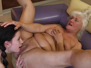 Mature blonde lesbian Isadora seduces a well done overcast Juliene
