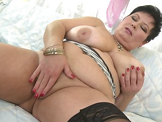 Abrupt haired mature lady Moira V. in a hot solo play operation
