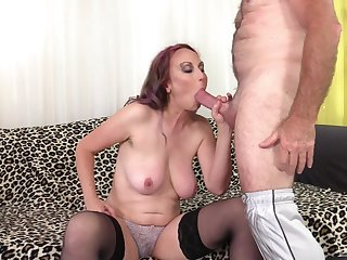 Pierced mature redhead Zoe Matthews gets cum on face from an old guy