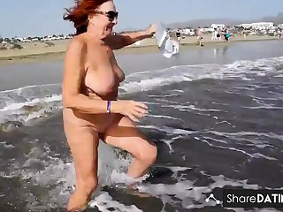 Matured woman shows her charms in the dunes