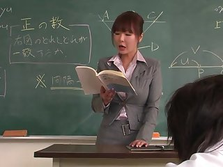Lecturer helps a well-draped schoolgirl to concentrate on the giving out