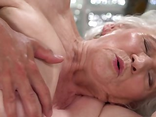 A nasty old granny is fucked on the side by a dude totally hard
