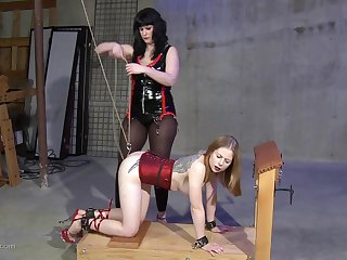 Dark haired lesbian fuck up puff up gives her blonde slave a guestimated sex session