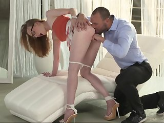 Milky white redhead gives a gorgeous blowjob