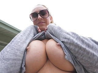 Buxomy gold is displaying her phat knockers winning of the camera, near a naughty stranger