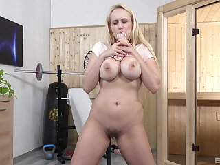 Blonde wife works her pussy with a distinguished dildo