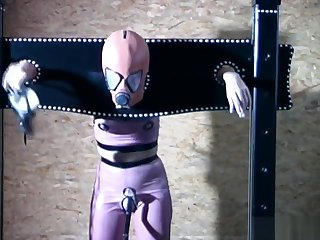 Gimp girl locked in box and pillory