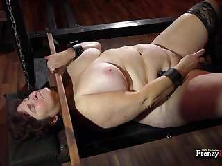 Matured fat whore Hana is locked in stocks as A she masturbates