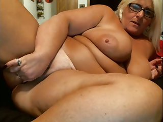 Giant breasted blonde mature virago is ergo into masturbating herself